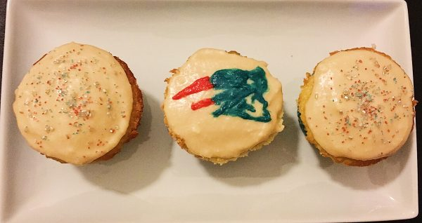 Super Bowl Sam 76 Cupcakes decorated with red, white, and blue sprinkles and the Patriots logo