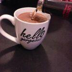 Bourbon pouring into Cherry Cordial Hot Cocoa