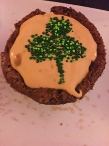 Shamrock Pot O' Gold Guinness Brownie with Caramel Irish Whiskey mousse with green sprinkles forming a shamrock