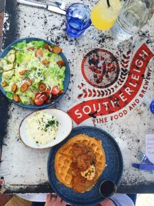 Chicken n Waffles and Caesar Salad and Cheesy Grits at Southerleigh