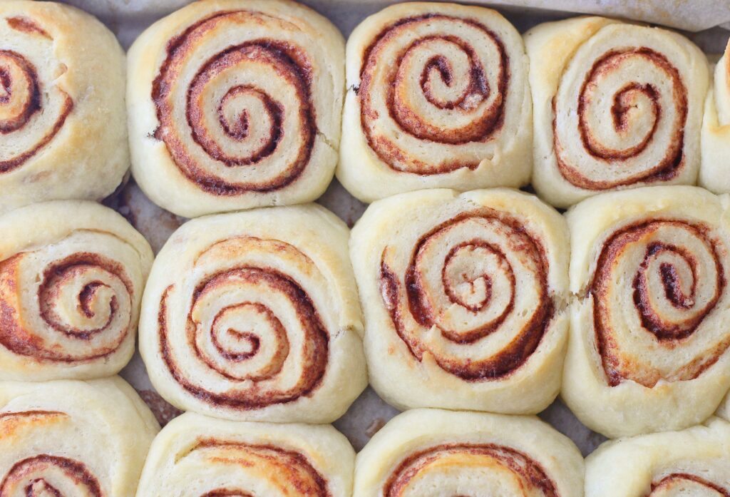 Top down view of baked hot cocoa rolls before frosting
