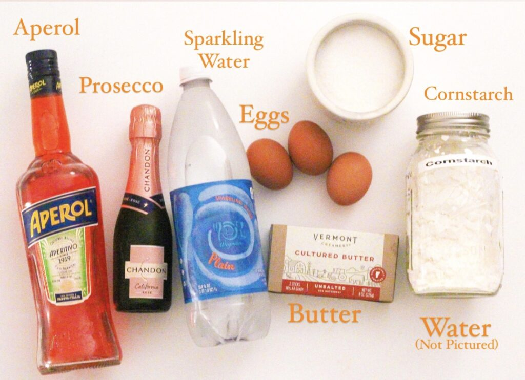 A top-down photo of all the ingredients for Aperol Spritz Pie