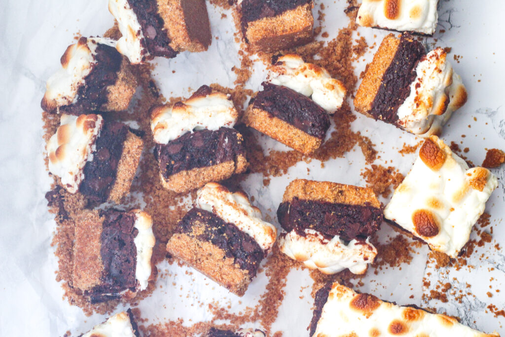 top down view of a bunch of Bailey's s'mores brownies on their sides to see the three layers of graham cracker crust, brownie center, and toasted marshmallow topping