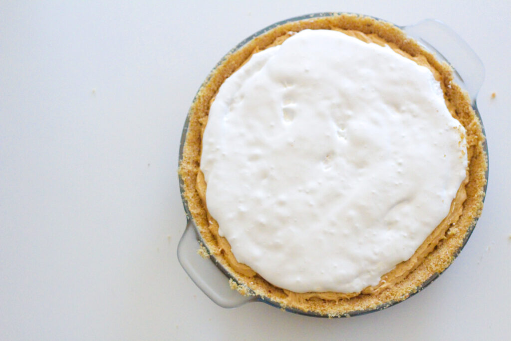 top down view of whole Fluffernutter Pie on the right side of the frame